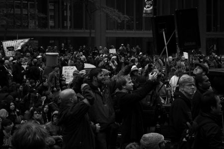 Thousands gather at the corner of King and York Streets in downtown Toronto, Ontario.