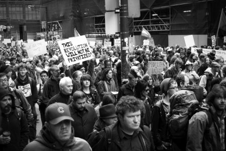 Thousands march in the streets of Toronto's financial district.