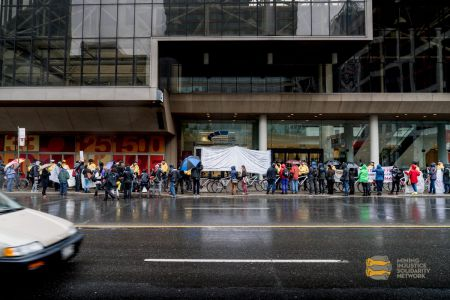Despite the rain and cold weather, many people came out to protest Barrick Gold and support the women who went inside to testify,