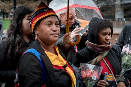 Joycelyn Mandi (foreground) and Everlyn Gaupe address a crowd of protesters who braved rain and cold weather to support them. Photo: Allan Lissner