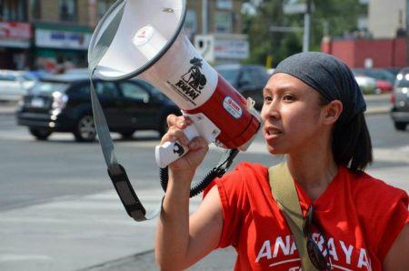 Rhea Gamana of Anakbayan Toronto leads the rally.