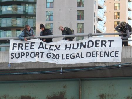 A drop by environmental justice activists in solidarity with Alex Hundert and other G20 prisoners while he was being held on 'bail violations'