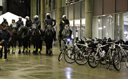 Riot police on horseback outside City Hall photo: Loretta Lime