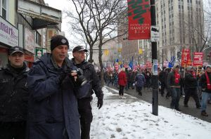 Officer 621 and friends, some of the many cops stationed to watch anti-capitalist demonstrators