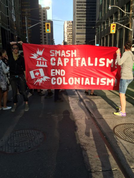 """Smash capitalism. End colonialism"" [Credit: Iris Robin]"