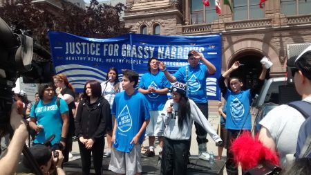 """Grassy Narrows Youth performing song """"Home to Me."""" Queen's Park, Toronto, Ontario. Madalene Arias for Toronto Media Co-op."""