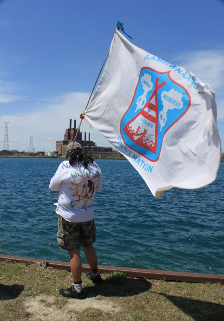 an Aamjiwnaang community member overlooks the St. Clair River