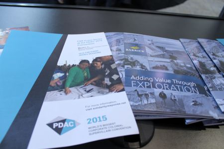The spoofed pamphlets sit next to mining industry reports inside PDAC's trade show area.