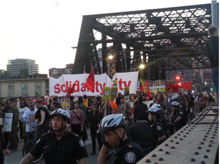 marchers on the bridge towards Porter airline (Photo: q_e_d)
