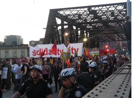 marchers on the bridge towards Porter airline (Photo: q_e_d)