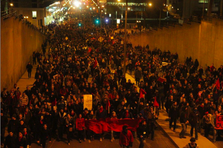 Photo from the Montreal Media Co-op showing protesters going through the underpass near the start of the march