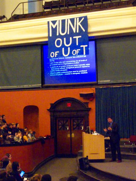 U of T President David Naylor looked surprised but tried to ignore the banner. He was instrumental in the undemocratic approval of the Munk contract.