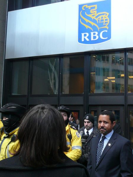 RBC representative being presented with a letter from the Unisto'ot'en people.  Photo: Hillary Lindsay