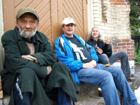 Nipper, Brian DuBourdieu and Sam Ash sit on the church steps at Dundas and Sherbourne on Friday, Oct. 4, 2013.