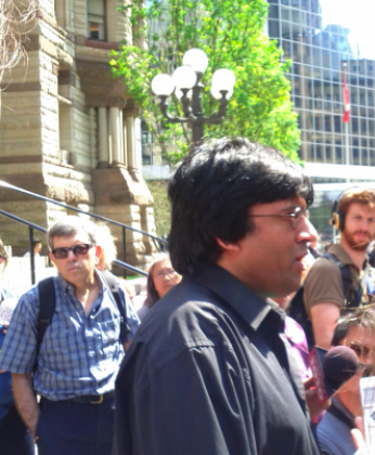 Jaggi Singh address the media outside Old City Hall. (photo: q_e_d))