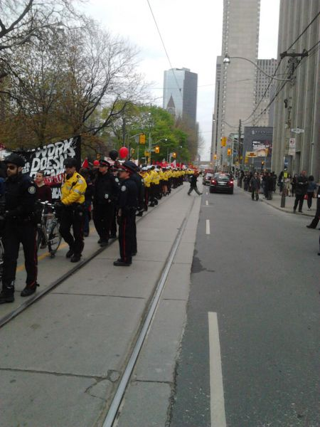 Heavy police presence alongisde the march.  Photo by Tyler Ledger (@mrdreamwood).