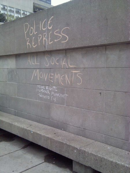In Nathan Phillips Square.  The man who wrote this was threatened with a mischief charge.  Photo by Megan Kinch.
