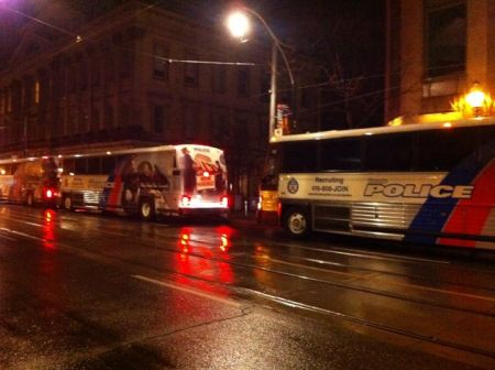 Riot buses pull up to Occupy Toronto (photo: Rebecca GL)