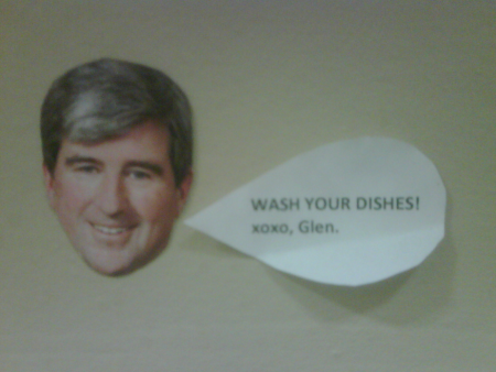 A photo form inside the occupation of a sign in Glen Murray's office urging staff to do dishes.