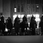 A line of riot cops on horseback lay in wait.