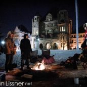 Daniel Amikwabe Bernard (right) and supporters brave the sub-zero temperatures to tend to the Sacred Fire at Queens Park