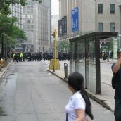 More cops 1 block east at Yonge St. and College St. (1/2 block east of Toronto police headquarters)