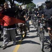 Police flank marchers - Photo: Activestills