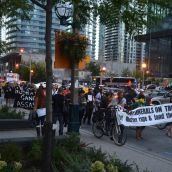 Participants marched down Bay Street in Toronto's financial district.