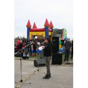 Ojistariyo speaking at Kanonhstaton (infront of Bouncy Castle #1)