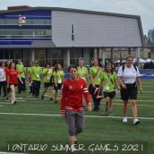 Diana Matheson leading the athletes out