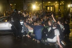Protesters trapped in front of Novatel by police. Photo: Activestills
