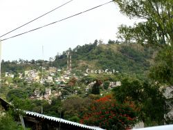 Nov. 26, 2009 - Coca-cola's voice is carved into a hill overlooking Tegucigalpa.