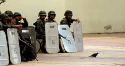 Nov. 27, 2009 - Soldiers wait behind the police line, in case the decision to supress the demonstrations is taken again.