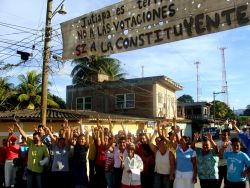 Nov. 29, 2009 - In the southern town of Jutiapa, the community has refused to be intimidated by the military and police.  Despite kidnappings and detentions, beating and death threats, and a ceaseless campaign of terror, they hang a banner on the main road through town declaring themselves against the coup and the elections.  They pose for a photo, cheering beneath their banner, knowing that police are stationed just a few blocks away.