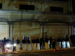Nov. 30, 2009 - With more people on the scene demanding President Zelaya's release, the police respond by adding to their numbers - by this point, there are police lines on three sides of the demonstration, with the Burger King on the other.