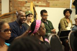 Member of the audience posing a question at Emancipation Day 2012 event