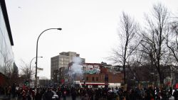 flashbangs  and tear gas are used by the SPVM with a helicopter overhead. contre sommet manif feb/2012