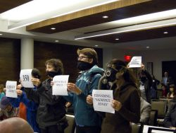 Silent Protest inside the hearing to bring attention to what discussion is being banned from the NEB hearings. Photo Credit: Michael Toledano