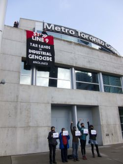 Banner drop in front the of Metro Convention Centre, where the NEB hearings are taking place this week in Toronto. Photo Credit: Michael Toledano