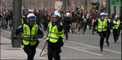 This photo of police running from protesters was widely shared on facebook.