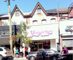 Cabbagetown residents discuss the situation outside of Yogurtys.