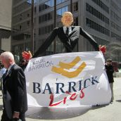 Giant Peter Munk Puppet with a Pinochio nose and blood on his hands is used to educate shareholders about how they can #suebarrick